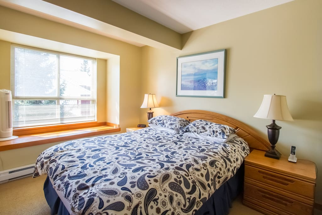 Bright and spacious master bedroom with ensuite bathroom, TV & balcony.