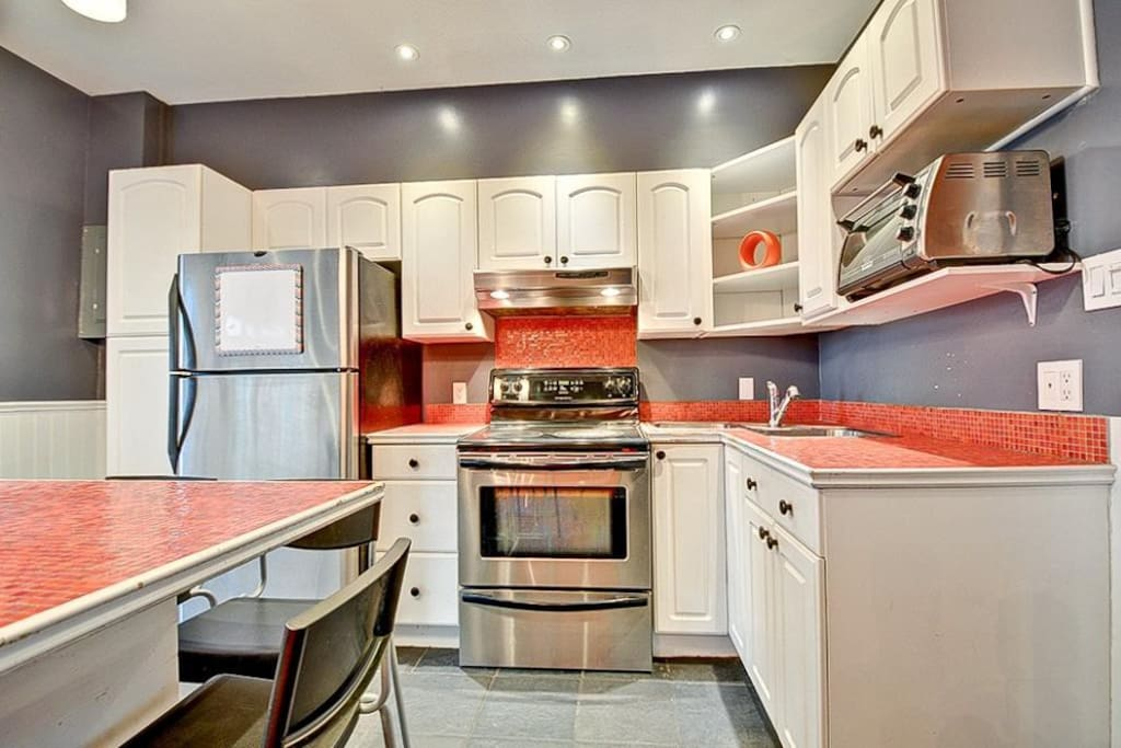 Nice kitchen with a center Isle. A dinning room next to it