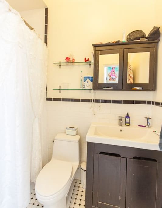 Clean bathroom with Toto toilet and tub.