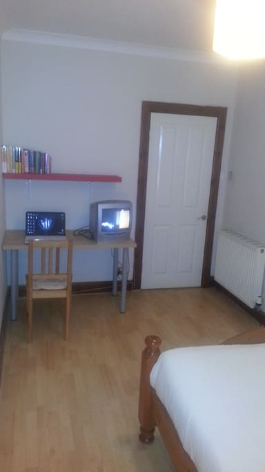 TV  and study section in room with internet access