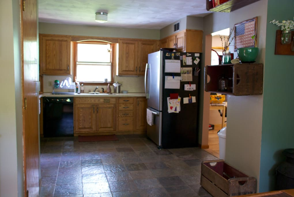 Large kitchen with new appliances.