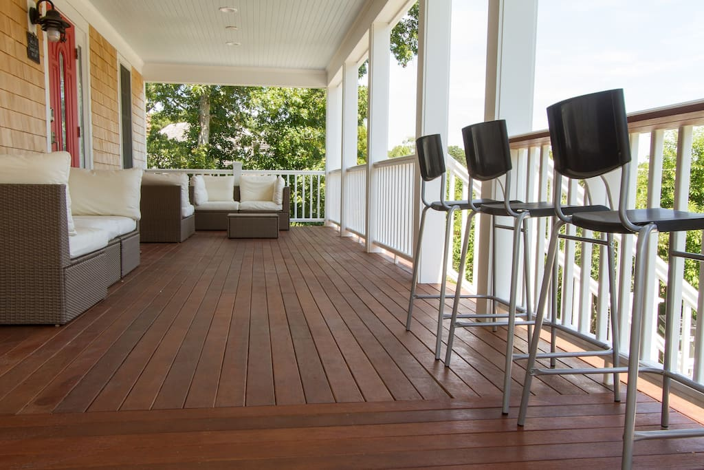 10 ft wide Porch with lounge furniture.  On the right, you will find a drink bar with 8 chairs