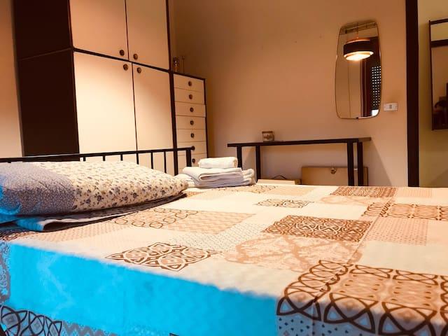 Bedrooms in big apartment in Bari