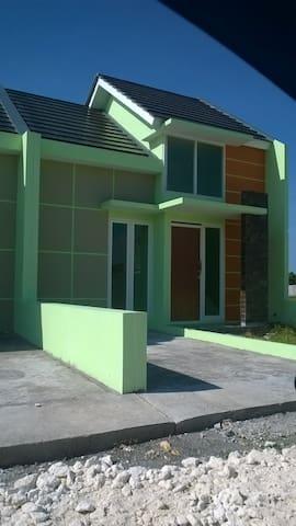 Rumah tinggal di perumahan 1 gate