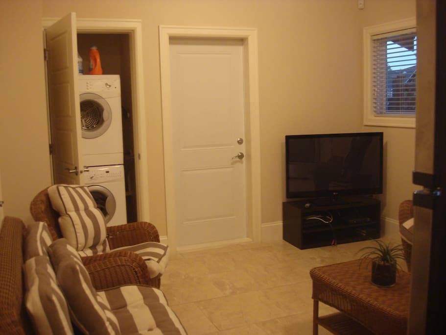 Lounge with laundry in the closet, Cable TV in the kichenette