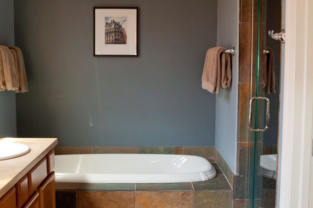 Deep soaking tub, walk-in shower, double sink and private toilet room