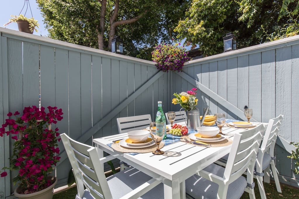 Outside dining table on your PRIVATE patio seats up to 6.