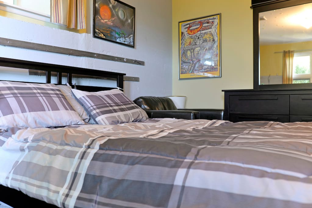 Queen Size real bed with electric heated mattress pad.