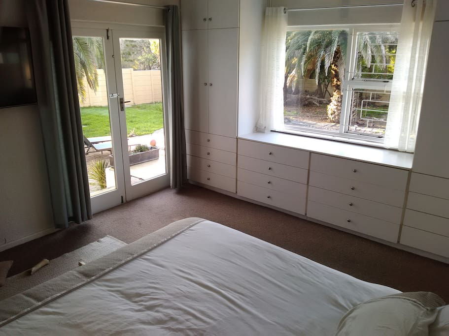 Bedroom with doors to garden
