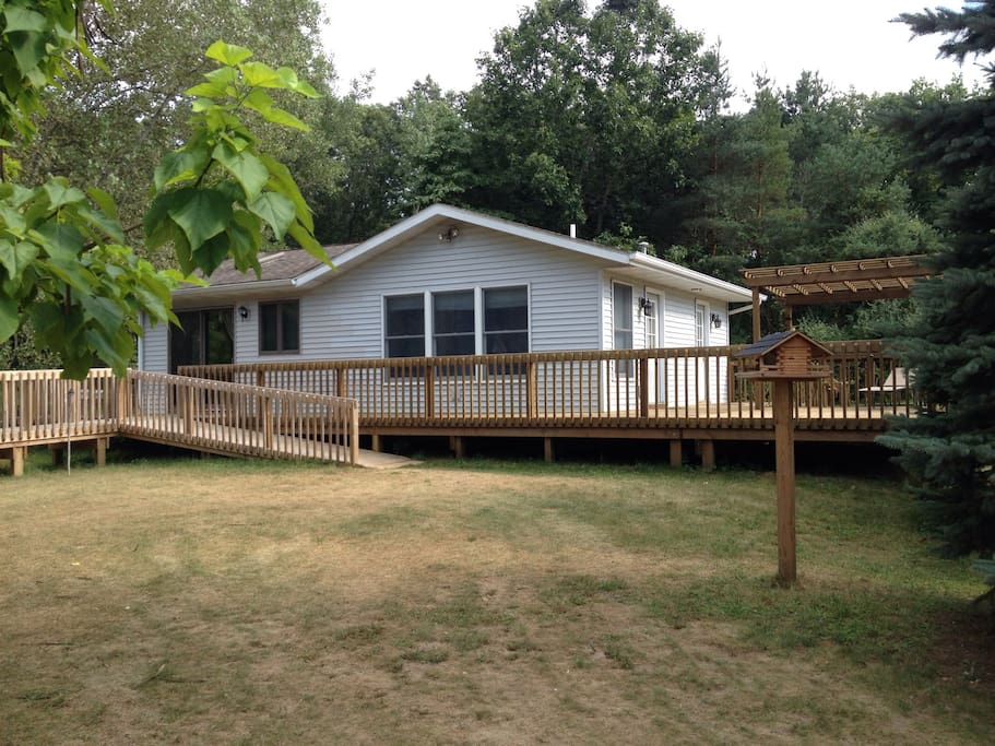Fully Accessible Guesthouse with wrap around decks to lake.