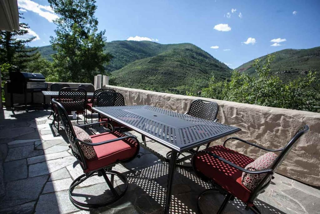 Large main level spacious deck with charcoal grill and 2 tables with seating for 8-12.