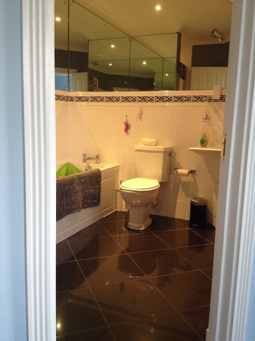 Private en-suite bath and shower