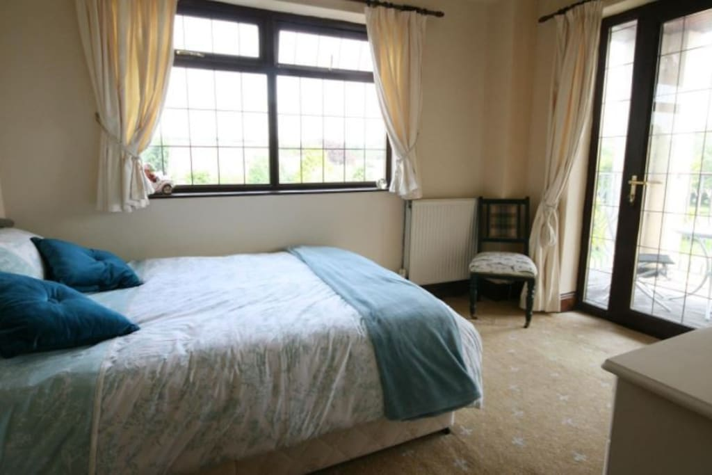 Bedroom 1, with access to breakfast veranda