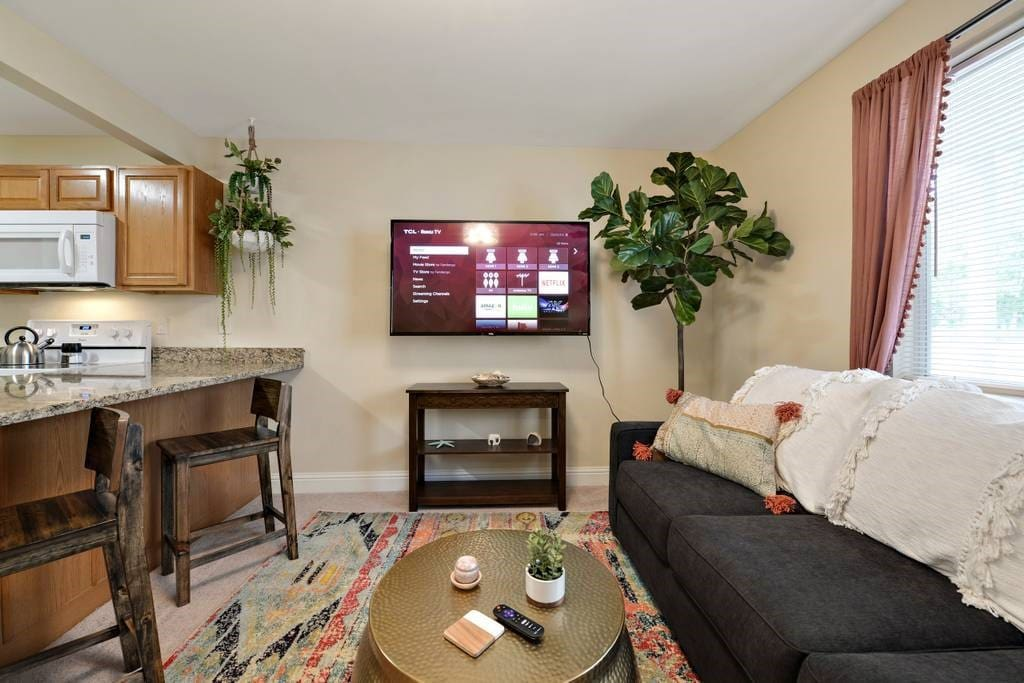 "Enjoy the 55"" big screen TV, on a swivel mount and with all of your Hulu, Amazon, Netflix, and HBO obsessions. Relax at the granite countertops on our driftwood beach chairs, and enjoy the natural light in this professionally decorated sea side retreat."
