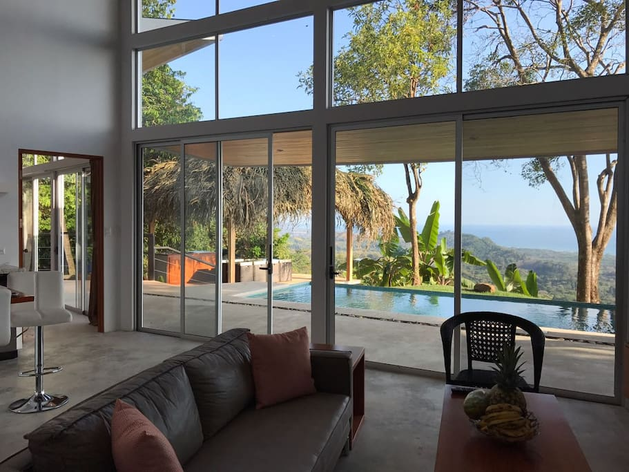 High ceilings and glass windows provide an extraordinary view from the living room
