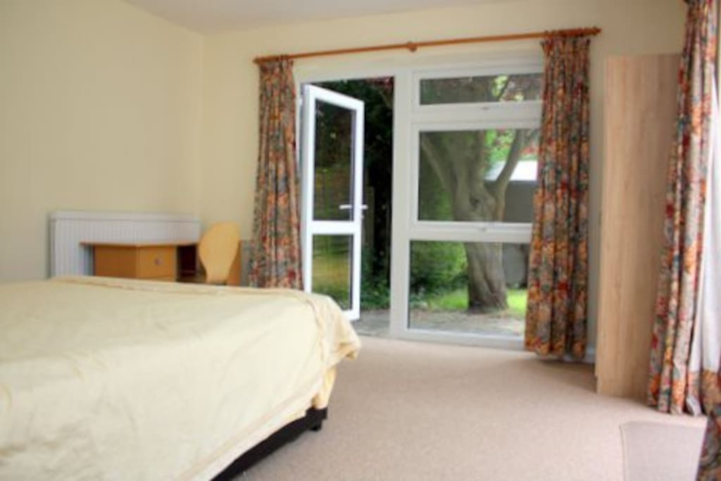 The room with direct access into the big garden, it include a wardrobe, desk with chair & lamp, and 2 bedside drawers