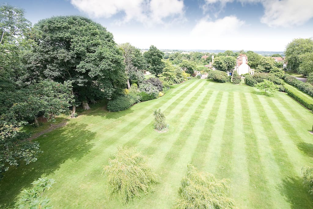 Three acres of stunning lawned private gardens
