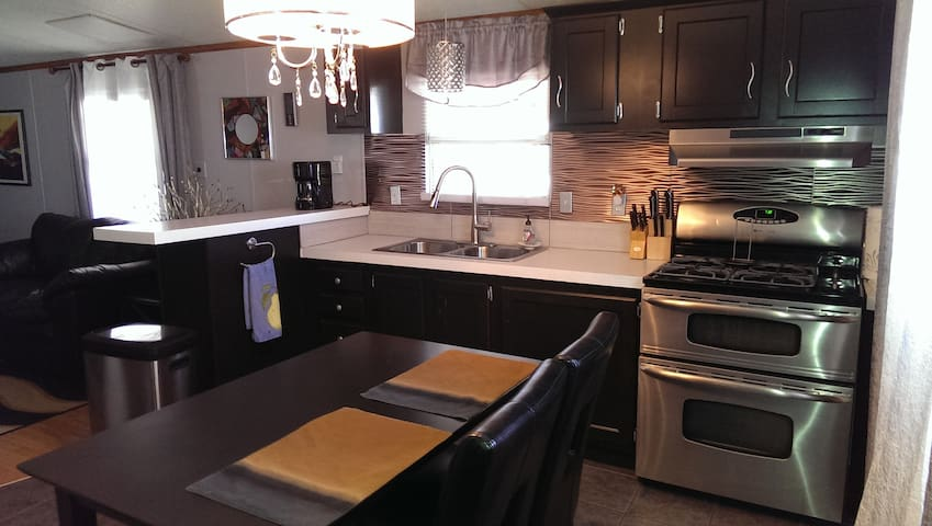 Kitchen with double oven and gas cook top