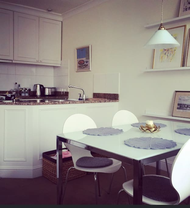 Open kitchen and seating for 4 people.
