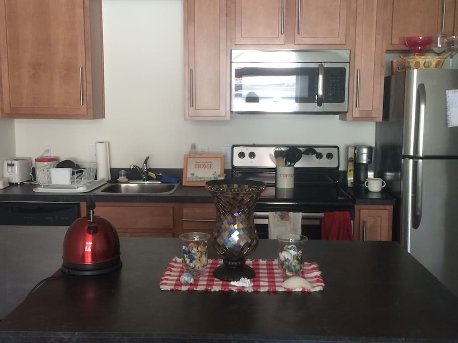 Huge kitchen with dishwasher, stove, oven, refrigerator, and garbage disposal.
