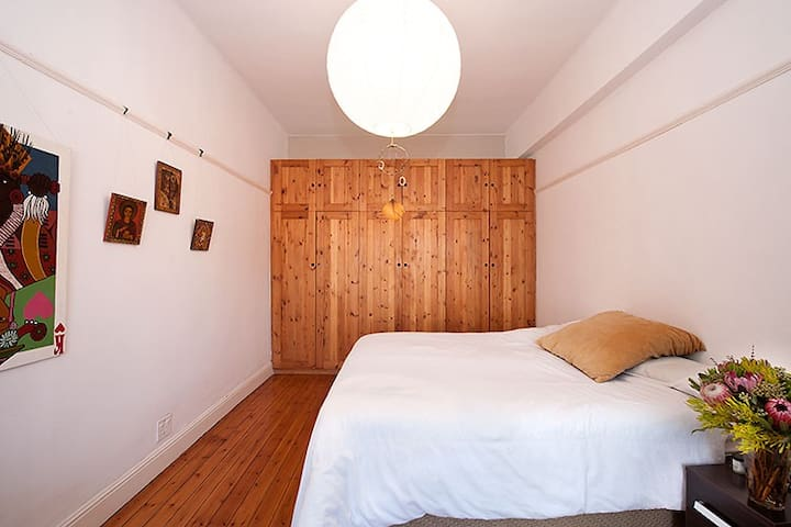 The main bedroom has ample space and  built in cupboards.