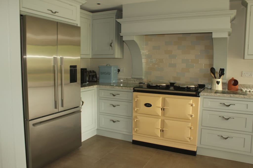 Lovely new kitchen with electric AGA and American style fridge/freezer, Miele dishwasher and Quooker boiling water ...