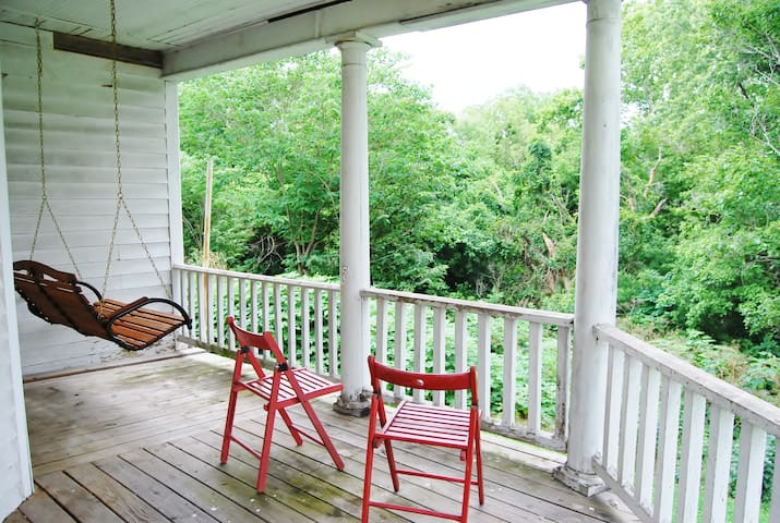 The back porch and swing.