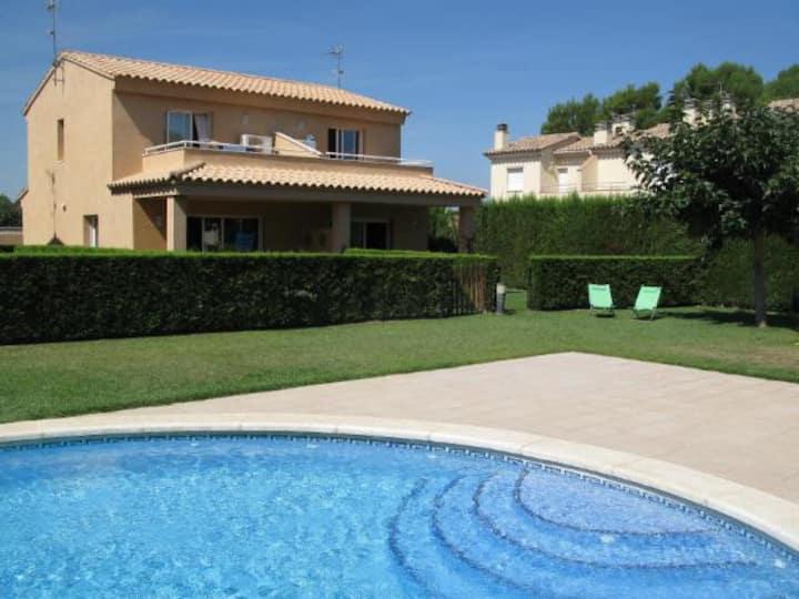 Casa Punta Milà. Private garden and  communal pool