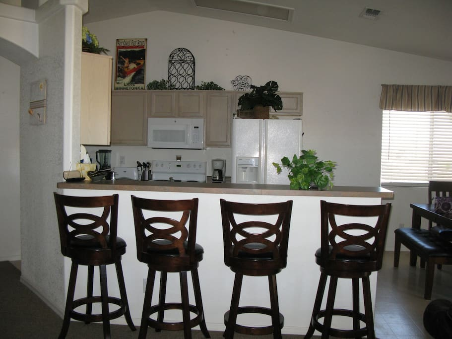 Additional seating facing full kitchen