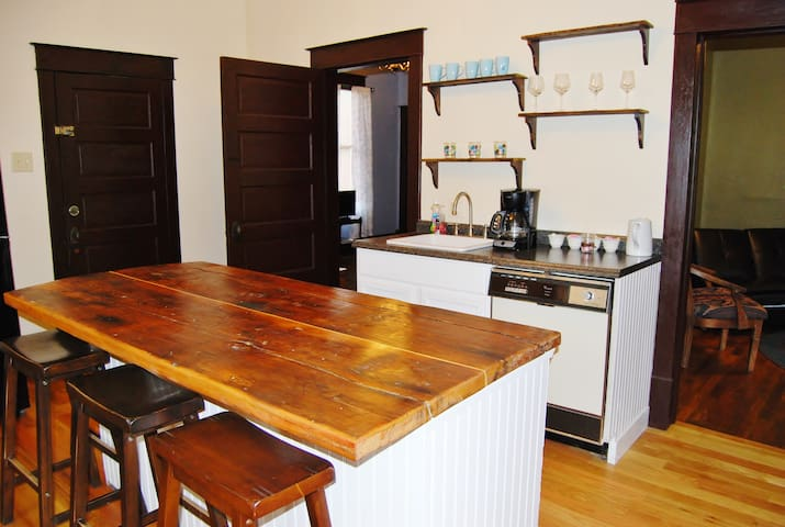 The kitchen. The island is made from early 1900 boards.