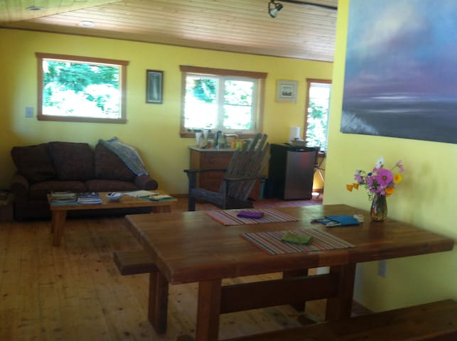 lounge area with comfortable couch, quiet refrigerator, electric kettle, coffee and tea service, and yummy food for you