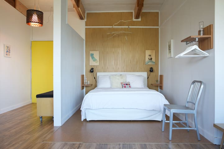 The bedroom with queen bed and luxurious linens