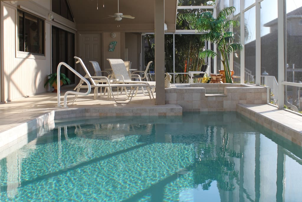 Lanai has all amenities including outdoor dining, lounges, kitchenette and heated spa and pool