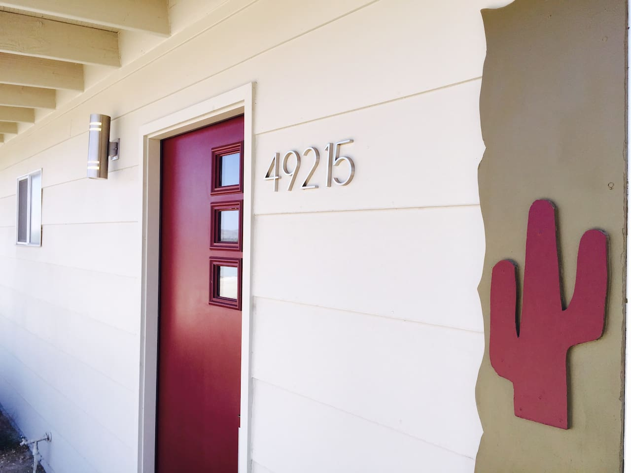 Original saguaro cutouts and a classic door meet you at the front door.