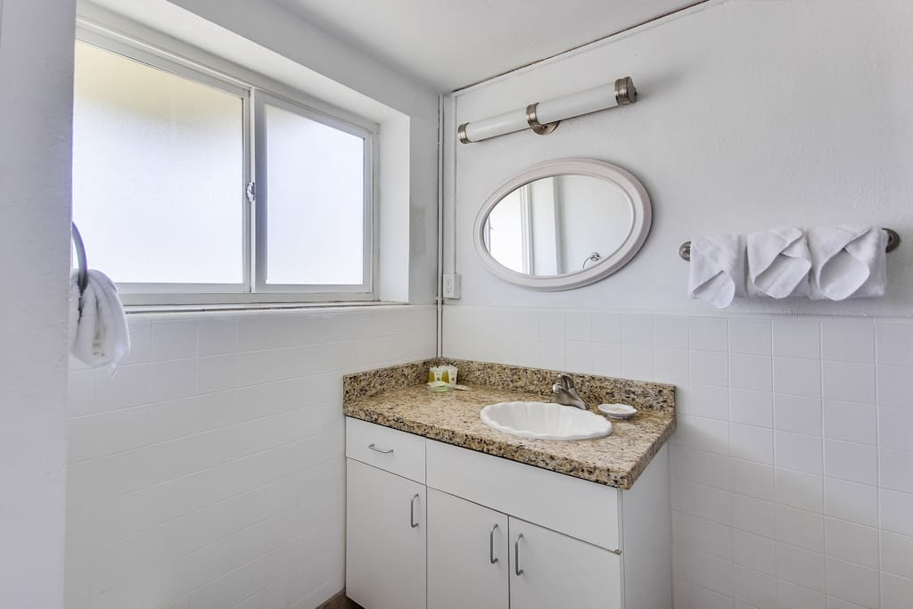 Comfortable bathroom, with shower and tub and hotel bath amenities.