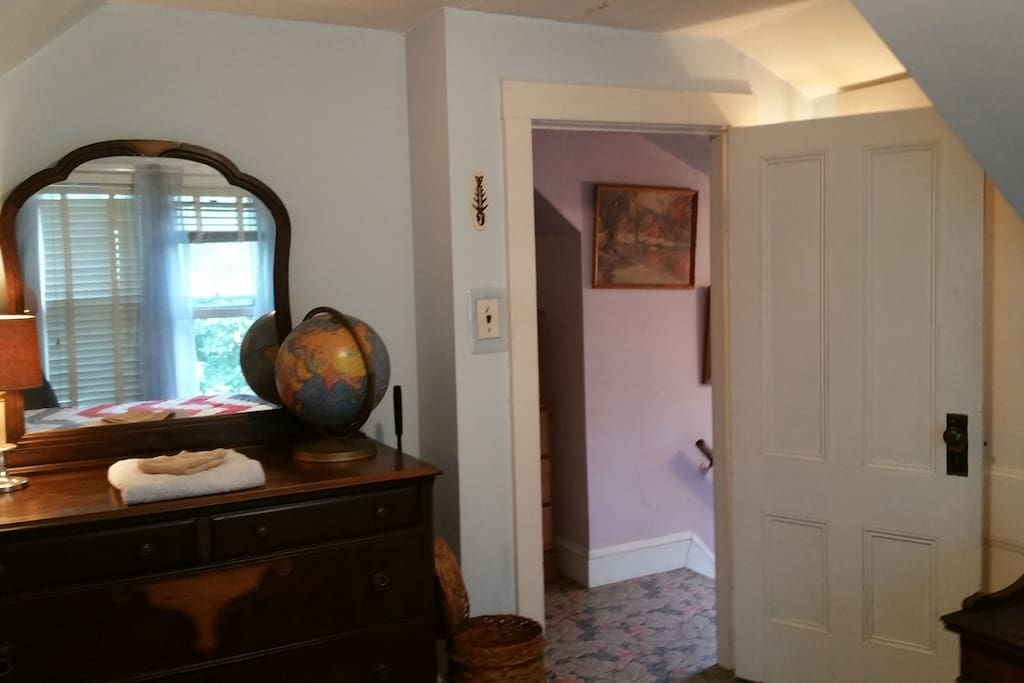 Open door to the 3rd floor hallway. Across the hall is the 3rd bedroom.