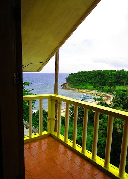 private veranda with beautiful views of the beach, sea, and the lighthouse