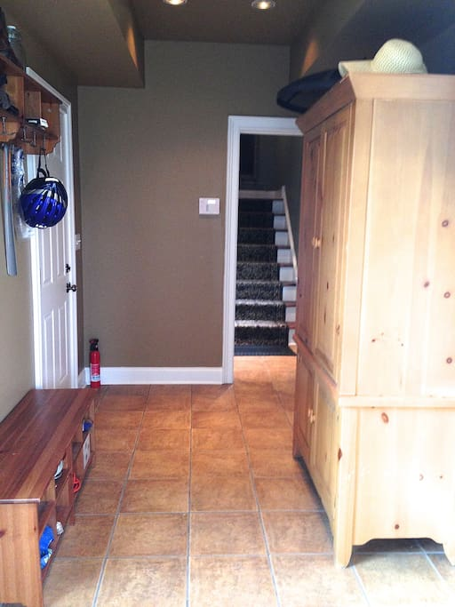 Mudroom facing stairway to Apartment/Carriage House