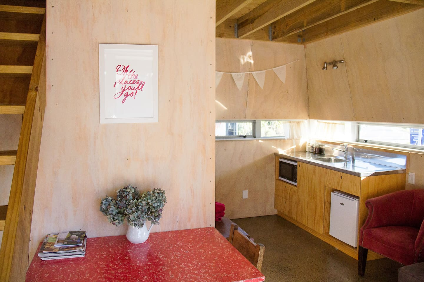 living and kitchen area. Our chalet has a kitchenette with a  fridge  and microwave