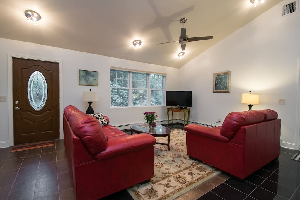 Rich red leather sofa and love seat. Gorgeous place room to  gather or just sit to read