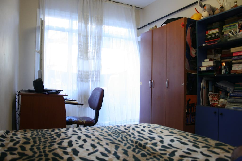 double bed, wardrop, bookcase, table, chair, table lamp, chest of drawers, balcony.