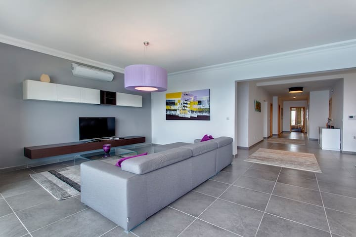 Open Plan living area with sea views and LCD TV
