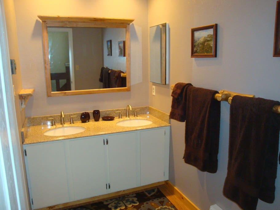 Upstairs bathroom with Granite sink and separate room with toilet and shower/bathtub