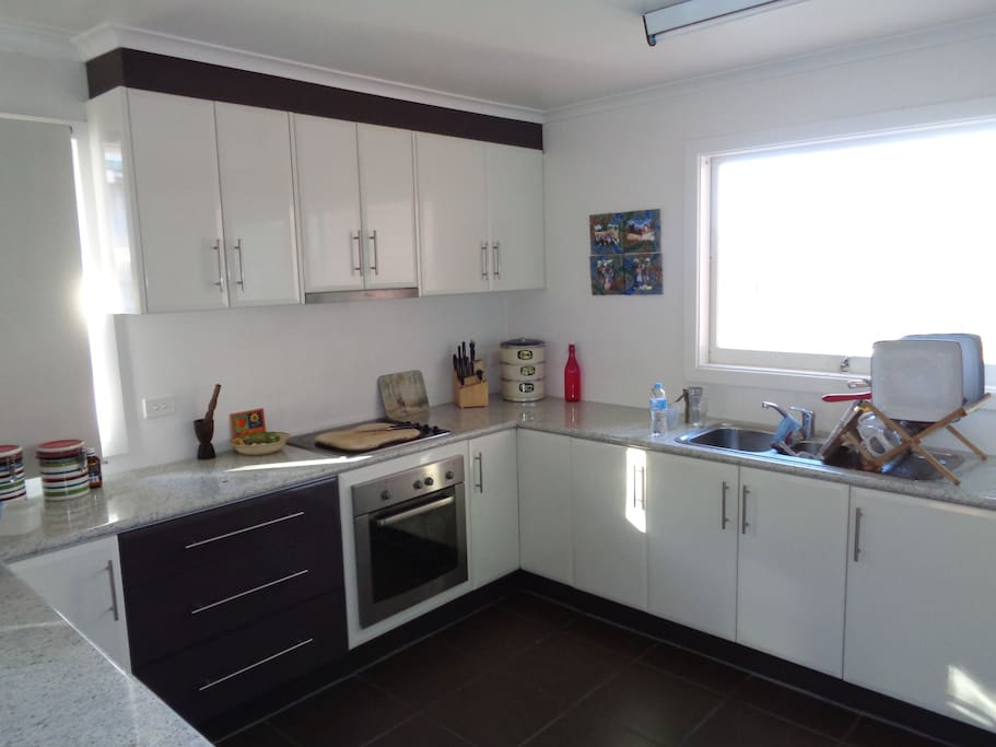 Full access to large kitchen area stocked with utensils. Private use when staying.