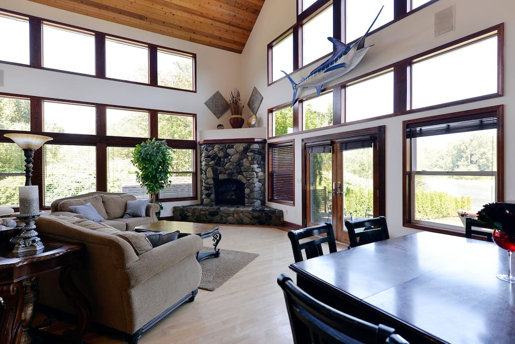 Living area. Enjoy the views of the river, a nice cozy fire in the fireplace, and company.