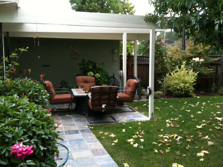 Front patio with lawn, firepit and comfy chairs.