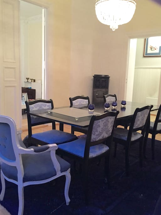 Large dining room with table suitable for eight dinner guest.