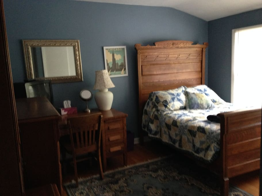 Bedroom with antique full size bed.