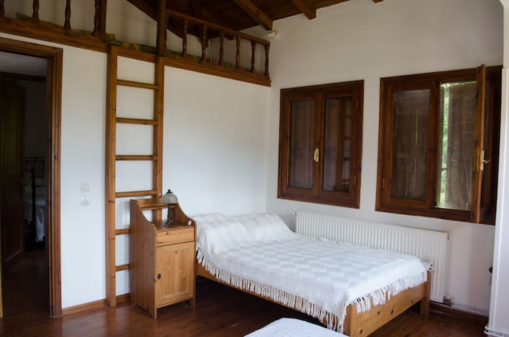The bed in the big bedroom