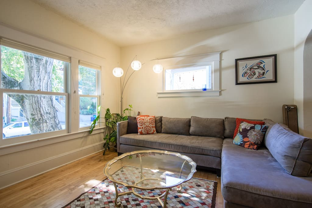 Comfy living room facing 7th Avenue. Opens to dining room and entry.